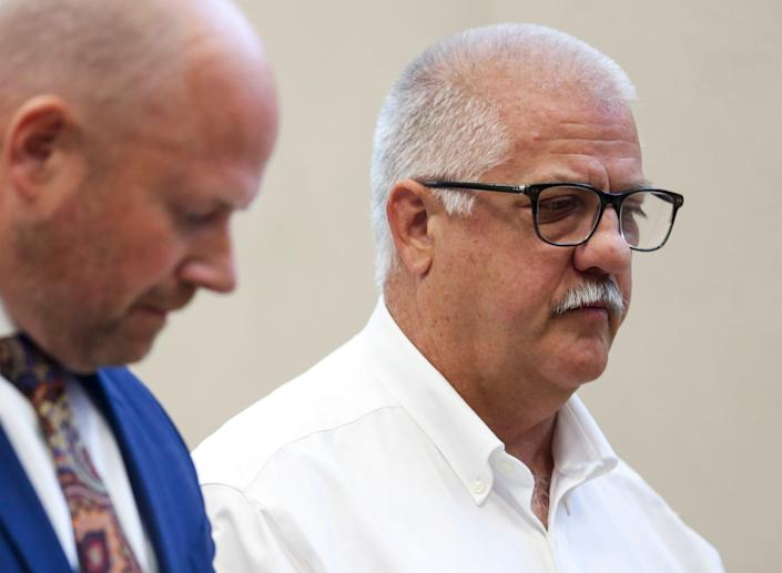 Former Oregon state Rep. Mike Nearman stands in Marion County Circuit Court while pleading guilty to official misconduct in the first degree Tuesday in Salem, Ore.