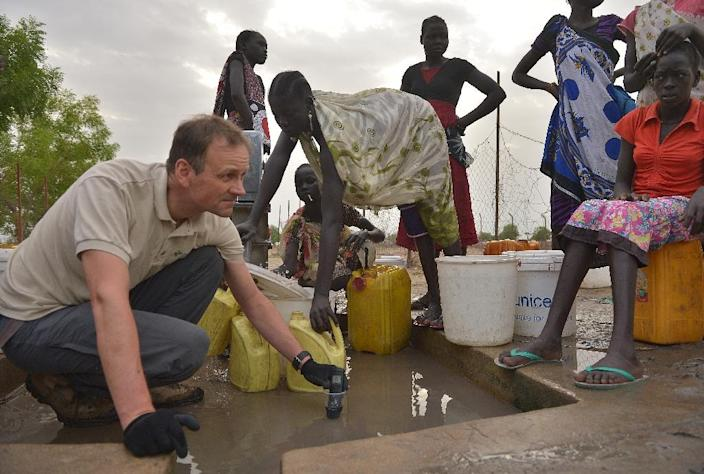 Klaus Stieglitz (L), from the German-based Sign of Hope organisation, said the research built on six years of hydrological tests by the group in the region (AFP Photo/Tony Karumba)