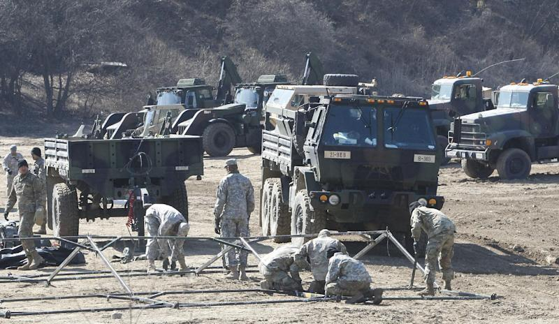 U.S. Army soldiers prepare their military exercise in Paju, near the border with North Korea, South Korea, Monday, March 6, 2017. North Korea on Monday fired four banned ballistic missiles that flew about 1,000 kilometers (620 miles), with three of them landing in Japan's exclusive economic zone, South Korean and Japanese officials said, in an apparent reaction to huge military drills by Washington and Seoul that Pyongyang insists are an invasion rehearsal. (AP Photo/Ahn Young-joon)