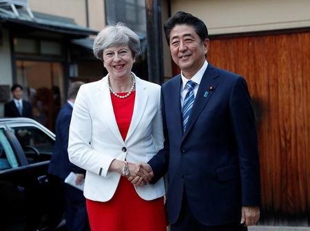 Britain's May visits Japanese warship before talks with Abe