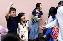 Supporters of local candidate Kelvin Lam celebrate at a polling station in the South Horizons West district in Hong Kong