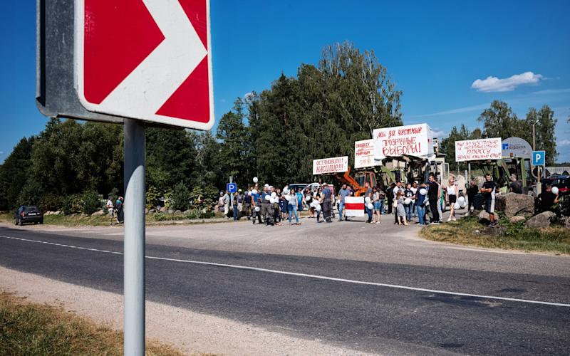 Workers at Hrodna's quarry came out to protest President Lukashenko's re-election on Friday - Misha Friedman/The Telegraph