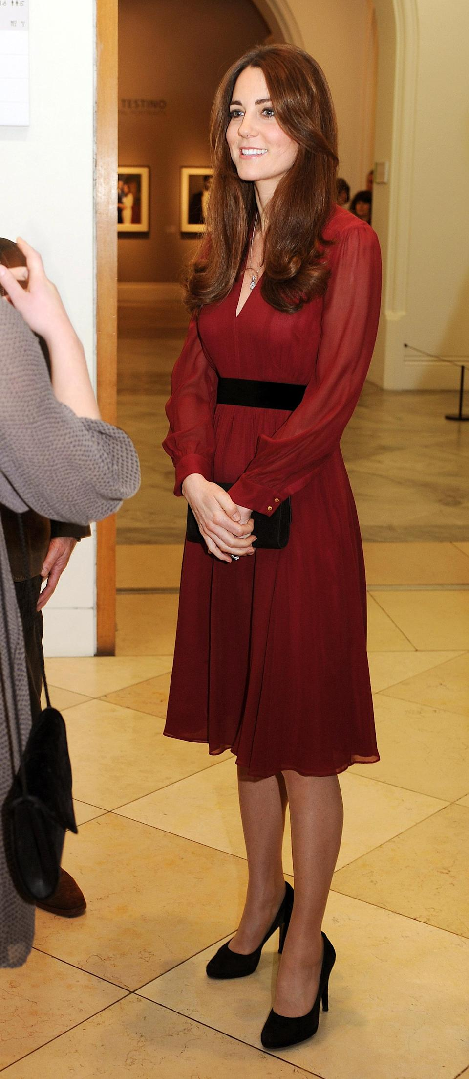 <p>On January 11 2013, the Duchess of Cambridge donned a burgundy-hued dress by Whistles to a private viewing at the National Portrait Gallery. Artist Paul Emsley famously unveiled his portrait of the royal on the evening. <em>[Photo: Getty]</em> </p>