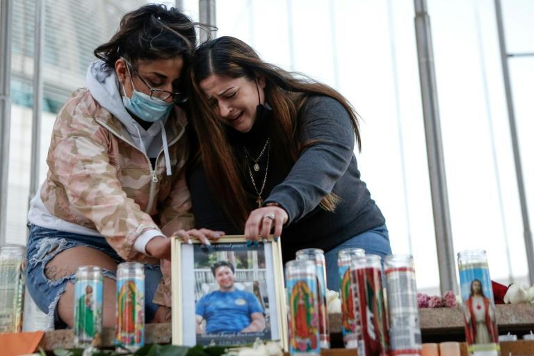 Christina Gonzalez and Alyssa Rubino mourn the death of their cousin, Michael Joseph Rudometkin, at a vigil for victims of the California rail yard shooting on May 27, 2021
