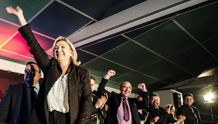 Marine Le Pen (L), president of France's far-right National Front party, reacts during a rally on February 7, 2015, in La Roche-sur-Foron (AFP Photo/Jean Philippe Ksiazek)