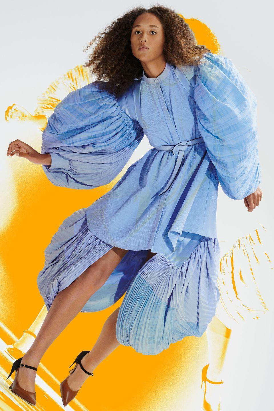 "<p>Loewe's Jonathan Anderson made showing remotely look like a creative endeavor with some true energy behind it. His resort 2021 collection came as a show-in-a-box containing paper dolls, and he evolved that concept for spring 2021 with what he termed a ""Show-on-the-Wall."" It was, effectively, a poster presentation, made in collaboration with M/M (Paris) and artist Anthea Hamilton, and was full of movement and whimsy. An artist's portfolio featuring giant fold-out posters of the looks was sent to editors, buyers, and friends of the brand. The special delivery also included a DIY set: a roll of wallpaper designed by the artist, wallpaper borders, wallpaper glue, a brush, and scissors. There was even a beetroot scent disc and a soundtrack by way of choral sheet music by Thomas Tallis to keep the experiential aspect of runway presentations alive and well via an entirely new approach. The clothes themselves spoke volumes, with an emphasis on the theatrical and sculptural. There were balloon sleeves, crinoline skirts, and other bold shapes sending the message that even though this is a moment where we're hiding out, we can still be as big and as bold as we want to be. —<em>Kerry Pieri</em></p>"