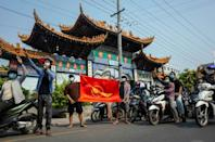 Protesters make the three-finger salute of resistance during a demonstration against the junta in Mandalay