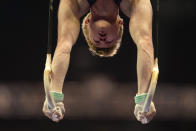 Riley Loos competes on the still rings during the men's U.S. Olympic Gymnastics Trials Thursday, June 24, 2021, in St. Louis. (AP Photo/Jeff Roberson)