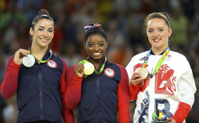 2016 Rio Olympics - Artistic Gymnastics - Final - Women's Floor Final - Rio Olympic Arena - Rio de Janeiro, Brazil - 16/08/2016. Gold medalist Simone Biles (USA) of USA, silver medalist Alexandra Raisman (USA) of USA (Aly Raisman) and bronze medalist Amy Tinkler (GBR) of Britain pose. REUTERS/Mike Blake FOR EDITORIAL USE ONLY. NOT FOR SALE FOR MARKETING OR ADVERTISING CAMPAIGNS.