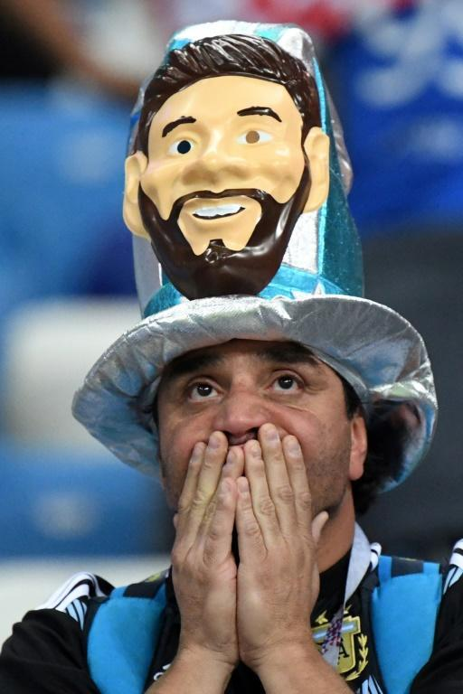 An Argentina fan reacts after being defeated by Croatia