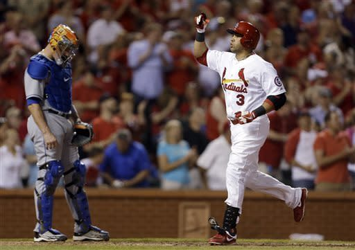 St. Louis Cardinals' Carlos Beltran, right, celebrates as he touches home near New York Mets catcher John Buck after hitting a three-run home run during the fifth inning of a baseball game Tuesday, May 14, 2013, in St. Louis. (AP Photo/Jeff Roberson)