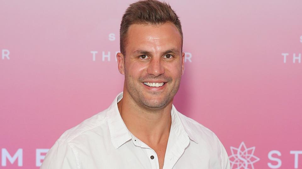 Beau Ryan with a pink backdrop