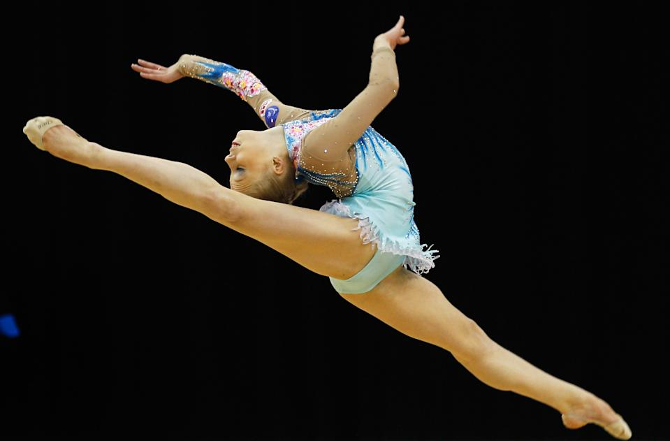 LONDON, ENGLAND - JANUARY 16: Kseniya Moustafaeva of France in action in the Individual All-Around during the FIG Rhythmic Gymnastics Olympic Qualification round at North Greenwich Arena on January 16, 2012 in London, England. (Photo by Paul Gilham/Getty Images)