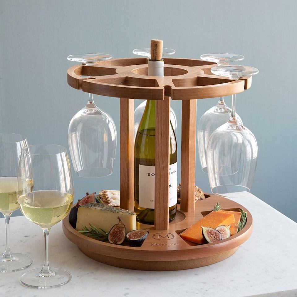 <p>This <span>Personalized Wine &amp; Cheese Carousel</span> ($140) will make for some fun times!</p>
