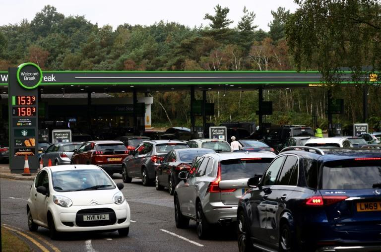Motorists have been backed up in long queues for fuel since last Friday (AFP/Adrian DENNIS)