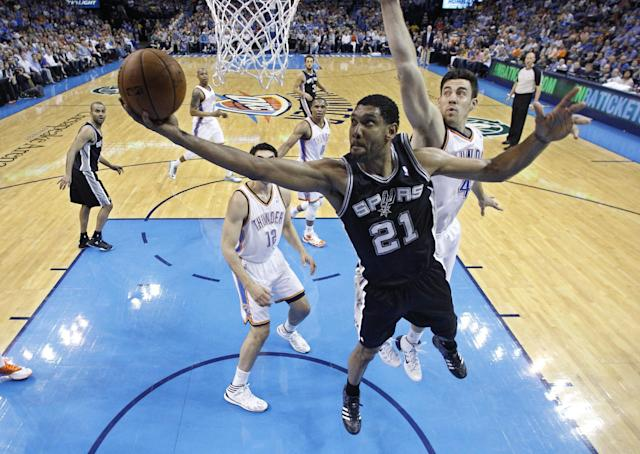 San Antonio Spurs forward Tim Duncan (21) shoots in front of Oklahoma City Thunder forward Nick Collison (4) during the first quarter of an NBA basketball game in Oklahoma City, Thursday, April 3, 2014. Oklahoma City won 106-94. (AP Photo/Sue Ogrocki)