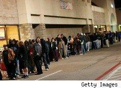 Shoppers line up outside of Best Buy on Black Friday