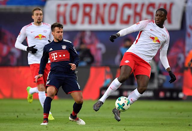 Soccer Football - Bundesliga - RB Leipzig vs Bayern Munich - Red Bull Arena, Leipzig, Germany - March 18, 2018 RB Leipzig's Ibrahima Konate in action with Bayern Munich's Juan Bernat REUTERS/Matthias Rietschel DFL RULES TO LIMIT THE ONLINE USAGE DURING MATCH TIME TO 15 PICTURES PER GAME. IMAGE SEQUENCES TO SIMULATE VIDEO IS NOT ALLOWED AT ANY TIME. FOR FURTHER QUERIES PLEASE CONTACT DFL DIRECTLY AT + 49 69 650050