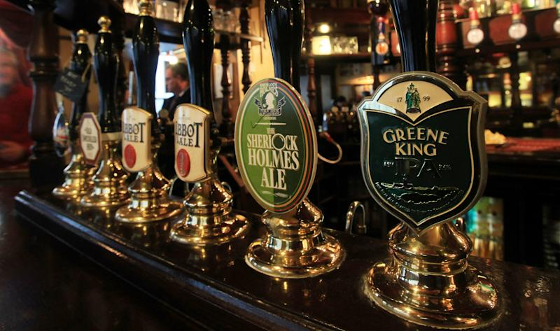 A selection of beers on draught at the bar of The Sherlock Holmes pub in central London, operated by pub and brewing company Greene King.