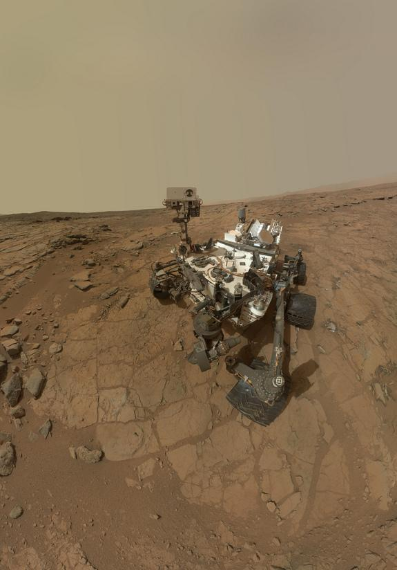 """This self-portrait of NASA's Mars rover Curiosity combines dozens of images taken by the rover's Mars Hand Lens Imager on Feb. 3, 2013. The portrait was taken at the rock target """"John Klein,"""" where the rover collected the first ever bedrock sa"""