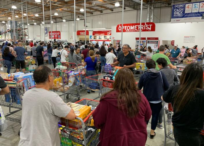 "<span class=""caption"">Shoppers in Los Angeles stock up on essentials: food, water and toilet paper.</span> <span class=""attribution""><a class=""link rapid-noclick-resp"" href=""https://www.gettyimages.com/detail/news-photo/shoppers-buy-toilet-paper-food-and-water-at-a-store-as-news-photo/1204234229?adppopup=true"" rel=""nofollow noopener"" target=""_blank"" data-ylk=""slk:Getty Images / Mark Ralston / AFP"">Getty Images / Mark Ralston / AFP</a></span>"