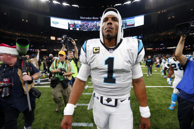 "FILE – In this Dec. 3, 2017 file photo, <a class=""link rapid-noclick-resp"" href=""/nfl/teams/car"" data-ylk=""slk:Carolina Panthers"">Carolina Panthers</a> quarterback Cam Newton (1) walks on the field after an NFL football game against the <a class=""link rapid-noclick-resp"" href=""/nfl/teams/nor"" data-ylk=""slk:New Orleans Saints"">New Orleans Saints</a> in New Orleans. (AP Photo/Butch Dill)"