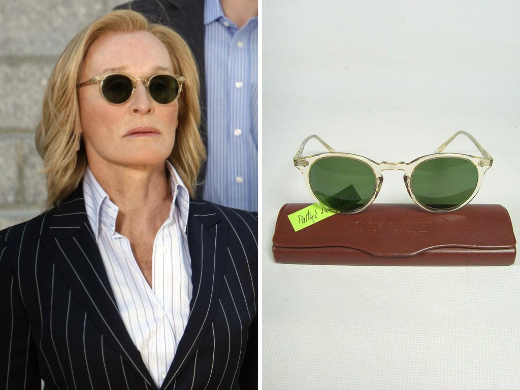 """Oliver Peoples round, green lens sunglasses. Clear acetate frames. These are the O'Malley style from the iconic eyewear line. Classic, vintage style. Pin detailing at temples. Comes with Oliver Peoples case. From Glenn Close's """"Damages"""" wardrobe.Designer: Oliver PeoplesColor: Clear frames. Green lenses.Length: 5 inches across front.Condition: Pre-owned in excellent condition. There are no signs of damage or excessive wear."""
