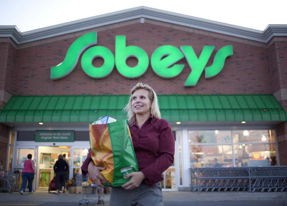 September 24, 2009 - Tracy Killins poses for a photo outside of a Sobeys in Ottawa Ontario where she collects travel rewards points and then tries to gain more value from them by exchanging them. Killins says she can collect double points by using her Sobeys card first and then paying with her Presidents Choice Mastercard for more points. (Photo by Pawel Dwulit/Toronto Star via Getty Images)