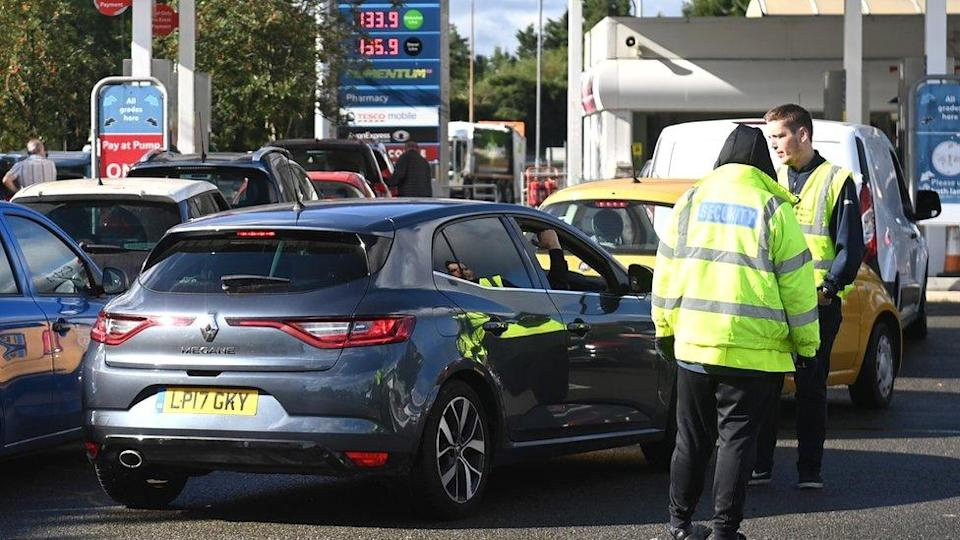 Cars queuing at a petrol station
