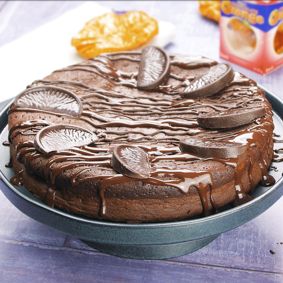 """<p>This chocolate orange cake, from Sarah Rainey's Three Ingredient Baking recipe book, is gooey and decadent.</p><p><strong>Recipe: <a href=""""https://www.goodhousekeeping.com/uk/food/recipes/a577857/chocolate-orange-cake/"""" rel=""""nofollow noopener"""" target=""""_blank"""" data-ylk=""""slk:Three-ingredient Chocolate Orange Cake"""" class=""""link rapid-noclick-resp"""">Three-ingredient Chocolate Orange Cake</a></strong></p>"""