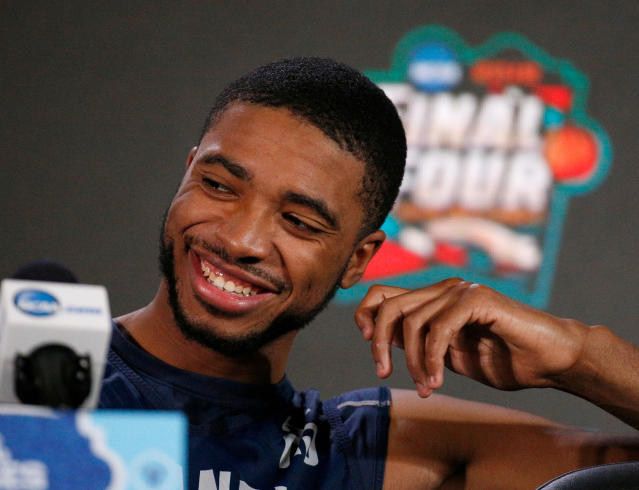Villanova's Mikal Bridges laughs during a news conference for the championship game of the Final Four NCAA college basketball tournament, Sunday, April 1, 2018, in San Antonio. (AP Photo/Brynn Anderson)