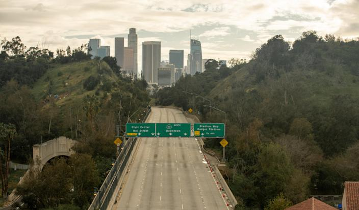 A Los Angeles freeway that usually has bumper-to-bumper traffic sits empty.