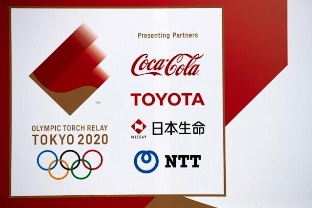 FILE PHOTO: A banner advertising Coca-Cola beverages, Toyota, Nissay and NTT, Olympic Games partner for Tokyo 2020, in Fukushima prefecture