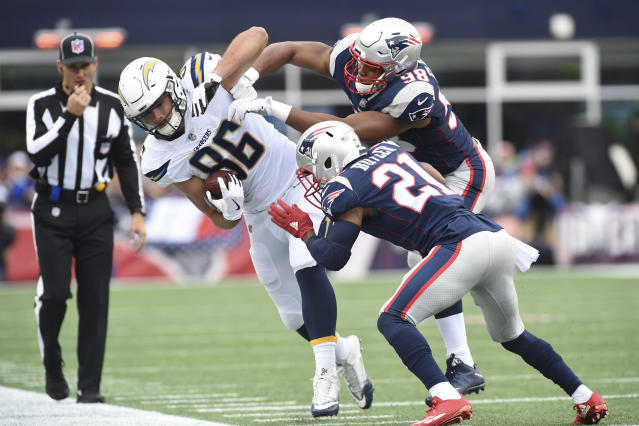 <p>Los Angeles Chargers tight end Hunter Henry (86) is pushed out of bounds by New England Patriots cornerback Malcolm Butler (21) and defensive end Trey Flowers (98) during the first half at Gillette Stadium. Mandatory Credit: Bob DeChiara-USA TODAY Sports </p>