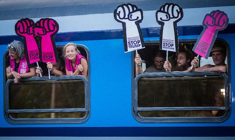 A special G20 train pulls in to Kornwestheim station in southern Germany to pick up passengers en route to the protests in Hamburg (AFP Photo/Christoph Schmidt)
