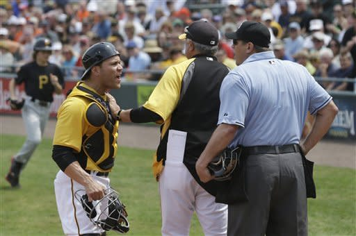 Pittsburgh Pirates catcher Russell Martin, front left, argues with home plate umpire Chad Fairchild, right, during the first inning of an exhibition spring training baseball game against the Baltimore Orioles, Sunday, March 24, 2013, in Bradenton, Fla. Martin was ejected from the game. (AP Photo/Carlos Osorio)