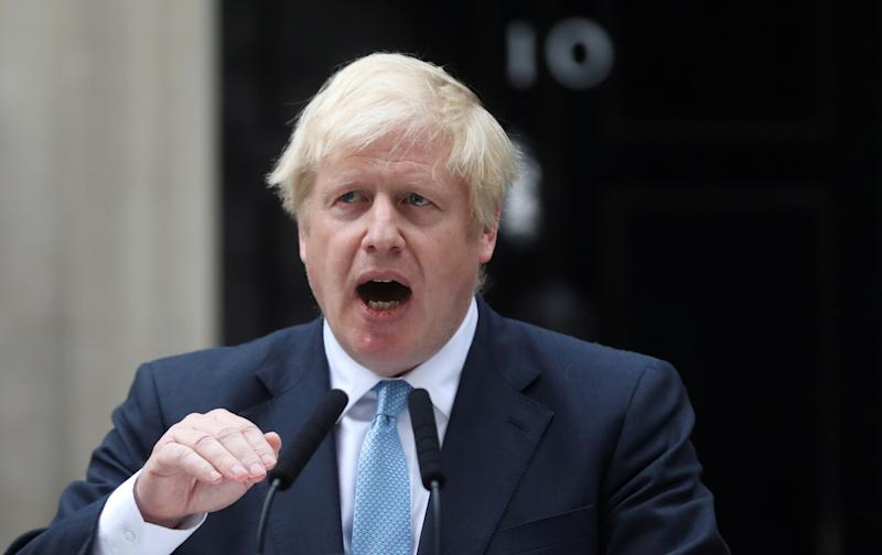 Britain's Prime Minister Boris Johnson addresses the media outside Downing Street in London, Britain, September 2, 2019. REUTERS/Simon Dawson