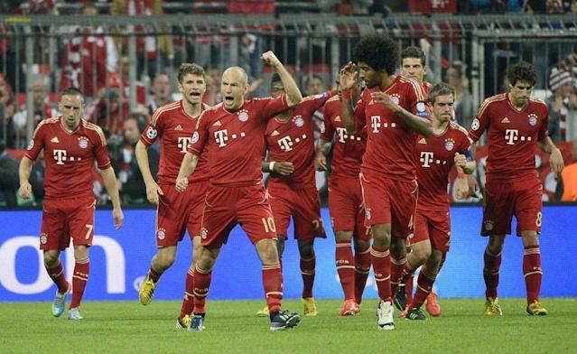 Bayern Munich's players celebrate after scoring during their Champions League semi final first leg match against Barcelona on April 23, 2013