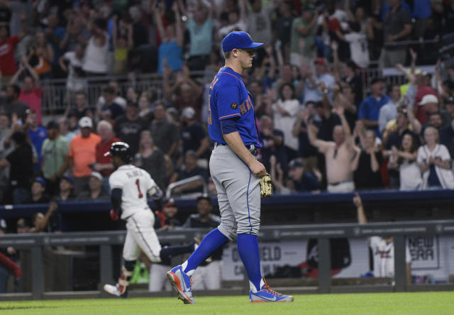 New York Mets pitcher Paul Sewald waits as Atlanta Braves' Ozzie Albies (1) heads to first after hitting a grand slam during the sixth inning of a baseball game Tuesday, June 12, 2018, in Atlanta. (AP Photo/John Amis)