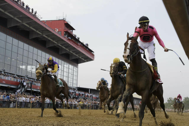 War of Will, ridden by Tyler Gaffalione, right, crosses the finish line first to win the Preakness Stakes horse race at Pimlico Race Course, Saturday, May 18, 2019, in Baltimore.(AP Photo/Steve Helber)