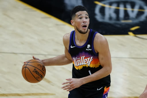 Phoenix Suns guard Devin Booker reacts to a call during the second half of the team's NBA basketball game against the New Orleans Pelicans, Tuesday, Dec. 29, 2020, in Phoenix. (AP Photo/Rick Scuteri)