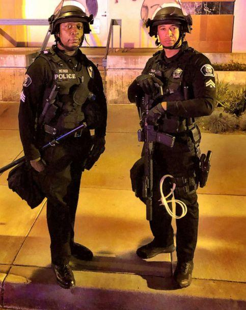 PHOTO: Corporal Ryan Tillman is pictured with fellow police officer Sgt. Kendall McIver while on duty in Chino, California. (Courtesy Ryan Tillman)