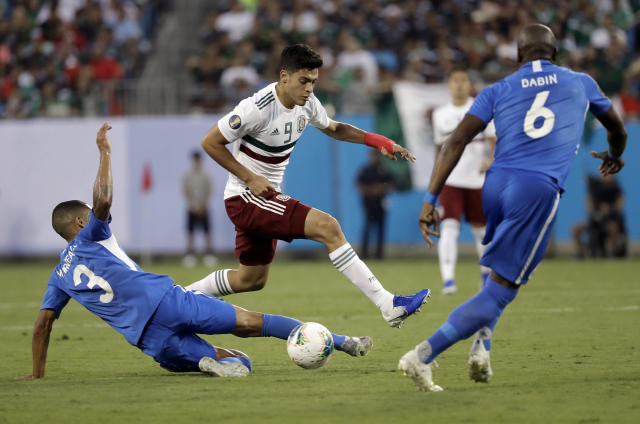 Mexico's Raul Jimenez (9) drives against Martinique's Jean-Sylvain Babin (6) and Joris Marveaux (3) during the first half of a CONCACAF Golf Cup soccer match in Charlotte, N.C., Sunday, June 23, 2019. (AP Photo/Chuck Burton)