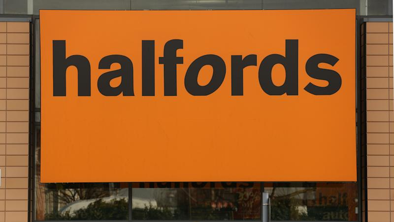 Halfords gets in gear with garage deal as profits stumble