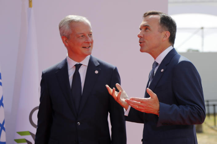 French Finance Minister Bruno Le Maire, left, welcomes Canada's Finance Minister Bill Morneau, at the G-7 Finance Wednesday July 17, 2019.The top finance officials of the Group of Seven rich democracies are arriving at Chantilly, at the start of a two-day meeting aimed at finding common ground on how to tax technology companies and on the risk from new digital currencies. (AP Photo/Michel Euler)