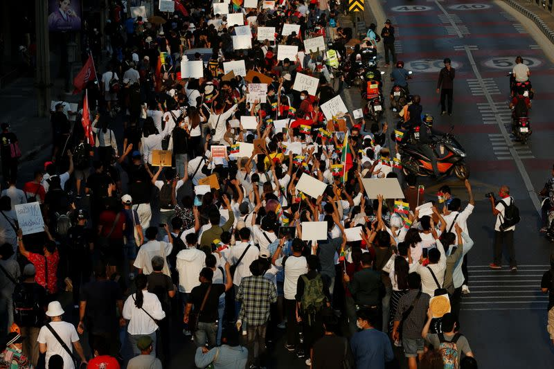 People attend an anti-government protest in Bangkok