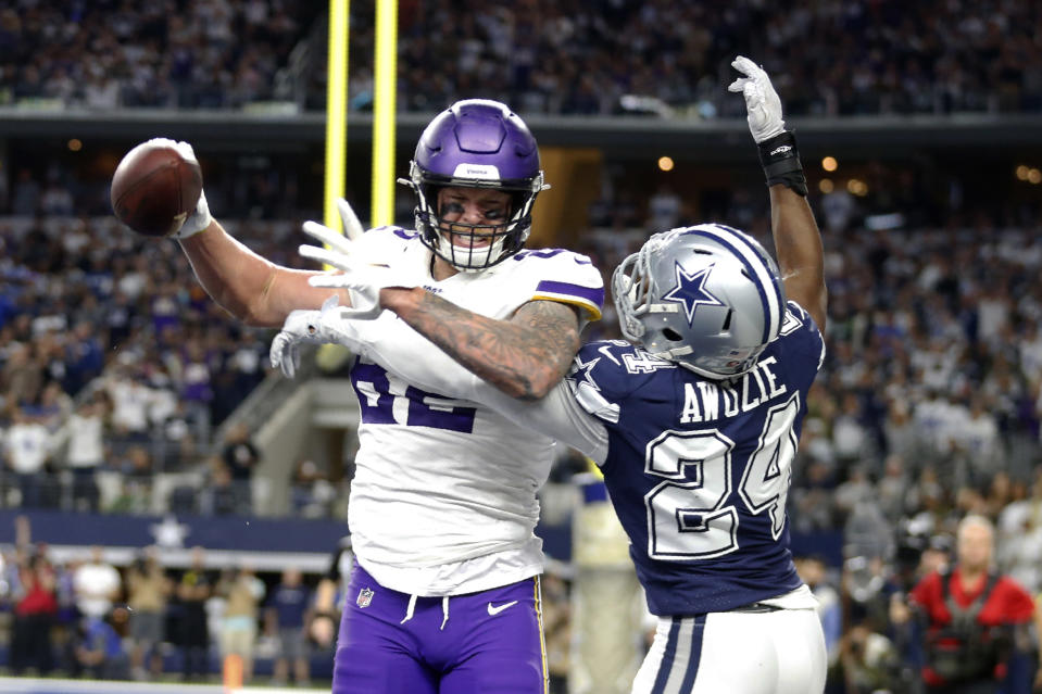 Minnesota Vikings tight end Kyle Rudolph (82) catches a pass for a 2-point conversion in front of Dallas Cowboys cornerback Chidobe Awuzie (24) during the second half of an NFL football game in Arlington, Texas, Sunday, Nov. 10, 2019. (AP Photo/Michael Ainsworth)