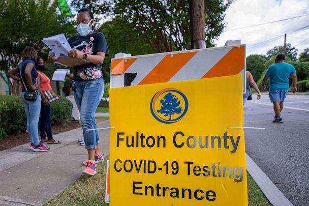 PHOTO: People wait in line at a walk-up COVID-19 testing site operated by Fulton County at the Center for Health and Rehabilitation in Atlanta, July 9, 2020. (Erik S Lesser/EPA via Shutterstock)