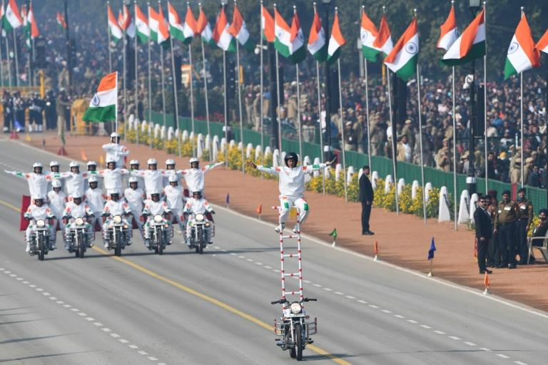 Female riders performed daredevil stunts on motorbikes to the delight of crowds at India's Republic Day parade (AFP Photo/Prakash SINGH)