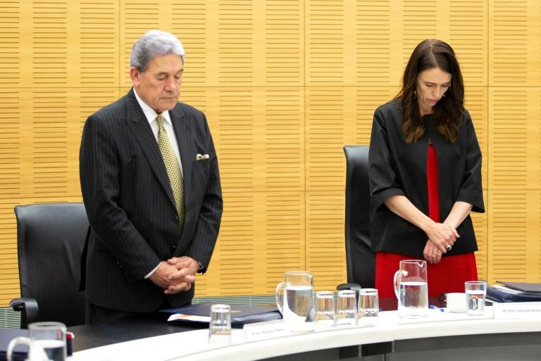 New Zealand Prime Minister Jacinda Ardern leads a minute's silence to remember the volcano victims
